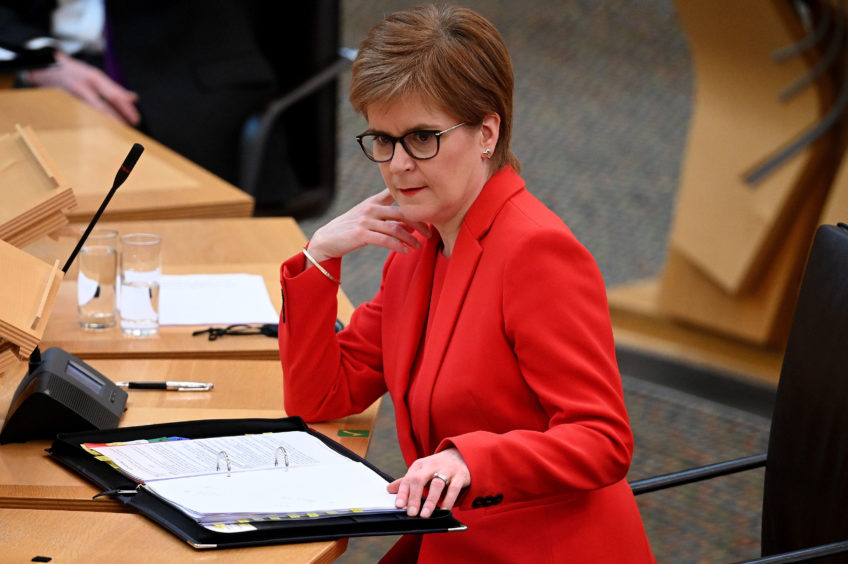 First Minister Nicola Sturgeon attending First Minster's Questions at the Scottish Parliament in Edinburgh today. Jeff J Mitchell/PA Wire