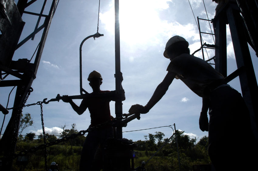 On the job: oil workers in Indonesia