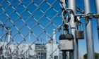 Gas Power Plant Behind Fence and Locked Gate; Shutterstock ID 1694681248; Purchase Order: EV supplement; Job: Winchester column; c8891653-4f95-4b83-ad88-6c82428ca59e