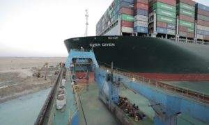 The Ever Given containership is now floating, the Suez Canal Authority has said, although challenges remain.