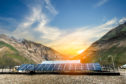 Power plant using renewable solar energy with sunset over the Gap in the Himalayan Mountain, Kashmir, India