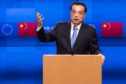 Li Keqiang, China's premier, gestures while speaking during a news conference at of the EU-China summit at the Europa building in Brussels, Belgium, on Tuesday, April 9, 2019. The EU and China managed to agree on a joint statement for Tuesday's summit in Brussels, papering over divisions on trade in a bid to present a common front to U.S. President Donald Trump, EU officials said. Photographer: Geert Vanden Wijngaert/Bloomberg