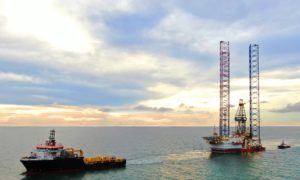 A drilling rig being towed offshore Sarawak, Malaysia