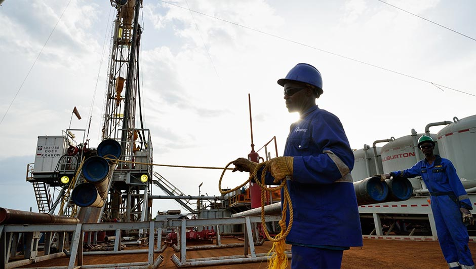 Worker in blue overall amid equipment