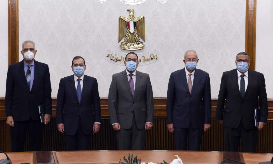 Five men in suits wearing masks