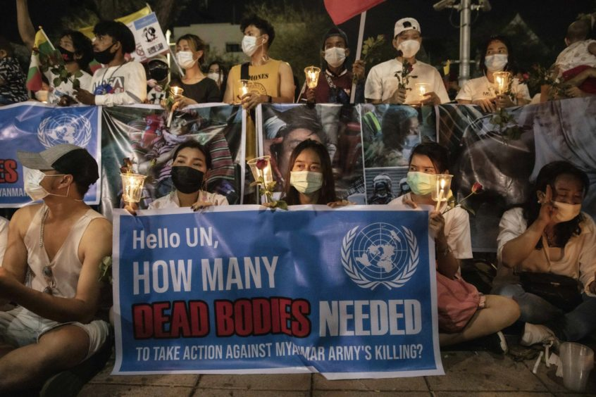 Demonstrators hold up banners during a protest outside the United Nations Building in Bangkok, Thailand, on Thursday, March 4, 2021. Photographer: Andre Malerba/Bloomberg