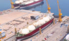LNG carrier in dock, with crane
