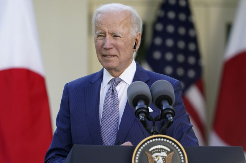 President Joe Biden listens during a news conference with Japanese Prime Minister Yoshihide Suga at a news conference in the Rose Garden of the White House, Friday, April 16, 2021, in Washington. (AP Photo/Andrew Harnik)