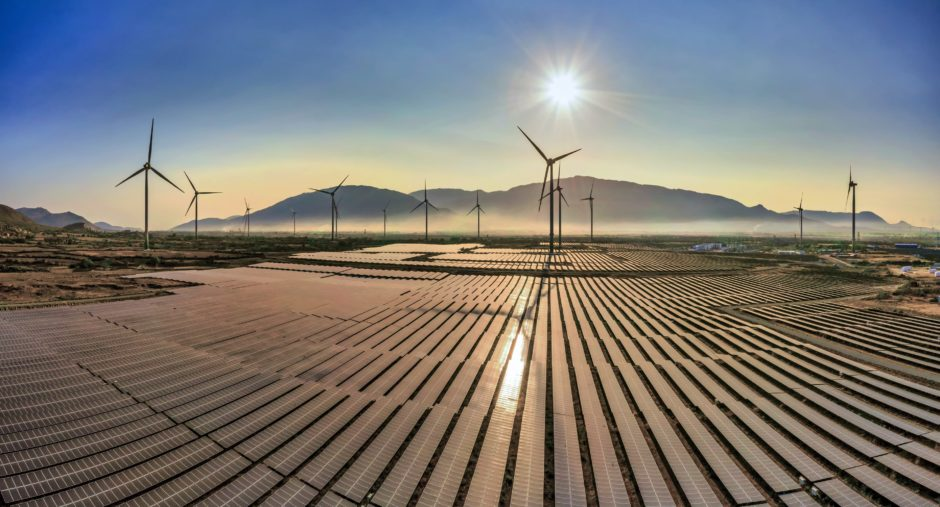 Aerial view of windmill and Solar panel, photovoltaic, alternative electricity source - concept of sustainable resources on a sunny day, Bac Phong, Thuan Bac, Ninh Thuan, VietnamBy: Nguyen Quang Ngoc Tonkin