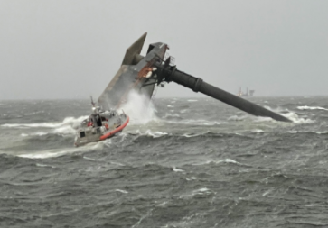 A Coast Guard Station Grand Isle 45-foot Response Boat-Medium boatcrew heads toward a capsized 175-foot commercial lift boat April 13, 2021 searching for people in the water 8 miles south of Louisiana. (U.S. Coast Guard photo courtesy of Coast Guard Cutter Glenn Harris)