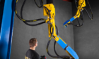 Swire is investing in robotic blast paint coating technology.
