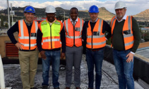Group of men in high vis jackets on site