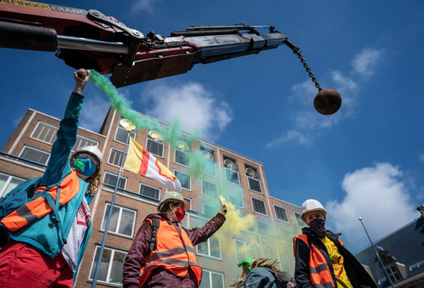 Campaigners demonstrate at Shell's head office in the Hauge during the annual shareholders meeting. Photo by Hollandse Hoogte/Shutterstock