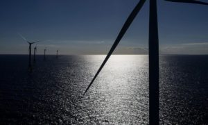 The GE-Alstom Block Island Wind Farm stands in the water off Block Island, Rhode Island, U.S., on Wednesday, Sept. 14, 2016. The installation of five 6-megawatt offshore-wind turbines at the Block Island project gives turbine supplier GE-Alstom first-mover advantage in the U.S. over its rivals Siemens and MHI-Vestas. Photographer: Eric Thayer/Bloomberg