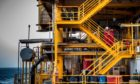 Workers work on a stairway aboard an offshore oil platform in the Persian Gulf's Salman Oil Field, operated by the National Iranian Offshore Oil Co., near Lavan island, Iran, on Thursday, Jan. 5. 2017. Nov. 5 is the day when sweeping U.S. sanctions on Iran's energy and banking sectors go back into effect after Trump's decision in May to walk away from the six-nation deal with Iran that suspended them. Photographer: Ali Mohammadi/Bloomberg