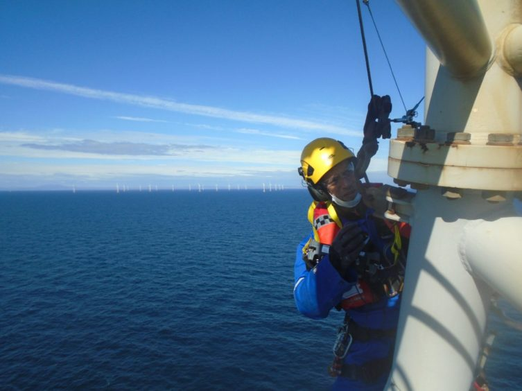 A PD&MS rope access technician working at a wind farm