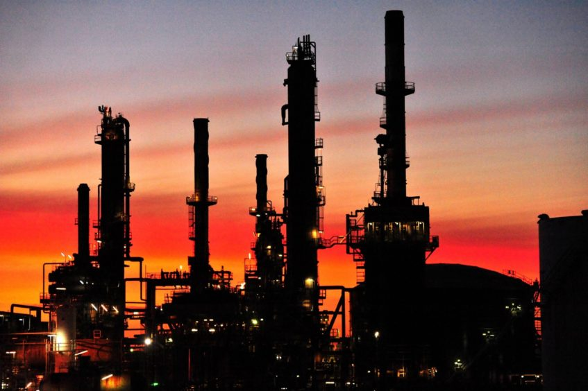 The Caltex Australia Ltd. Lytton refinery is silhouetted against a sunset in Brisbane, Australia, on Tuesday, Dec. 21, 2010.  Photographer: Eric Taylor/Bloomberg