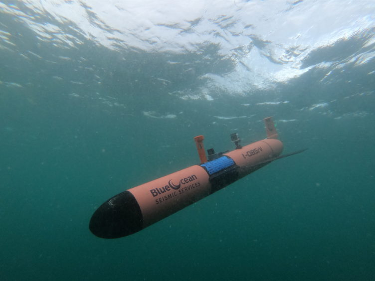 An AUV angles downwards into the water