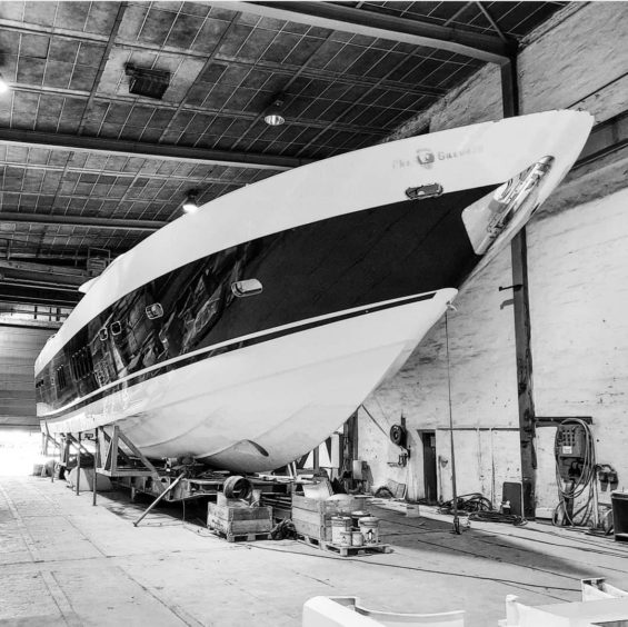 Black and white picture of yacht inside building