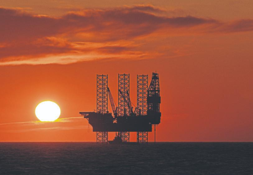 Oil rig with the sun setting in the North Sea.