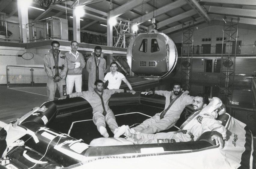 Beside the pool in RGIT's Offshore Survival Centre, King Street, Aberdeen, are members of the Royal Omani Police with centre staff. Picture taken 31 May 1988.