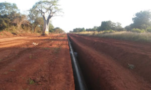 Red earth with a pipeline in a trench