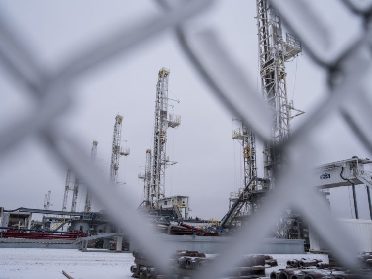 Idle drilling rigs near Midland, Texas, U.S, in February. Photographer: Matthew Busch/Bloomberg
