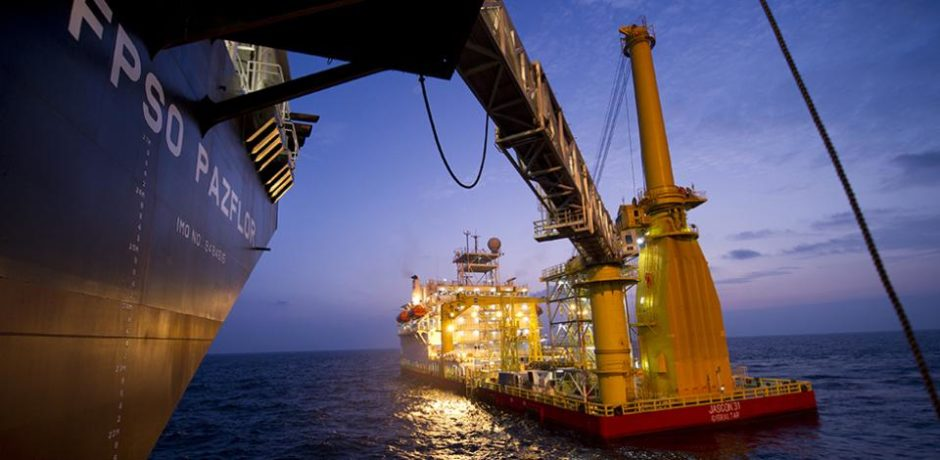 A ship and an FPSO at night in the sea