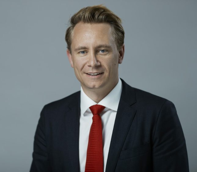 Man in grey suit with red tie