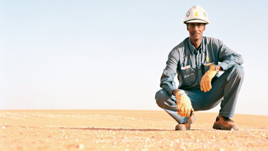 A man with a hard hat in the desert