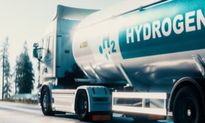 Hydrogen logistics concept. Truck with gas tank trailer on the road lined with solar power plants. 3d rendering; Shutterstock ID