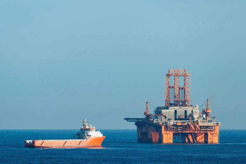 Supply vessel Normand Aurora next to West Phoenix oil rig in the North Sea. Olaf Kruger/imageBROKER/Shutterstock