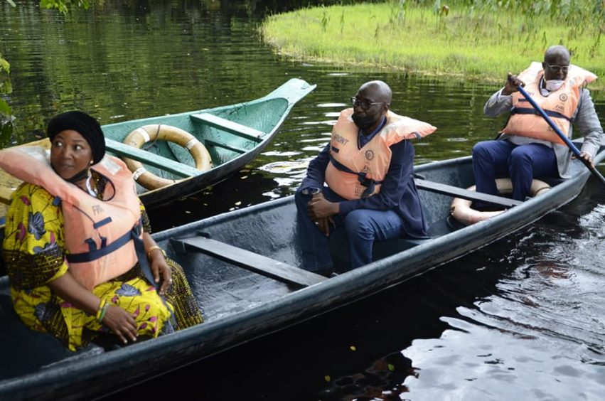 Two men and a woman in a canoe