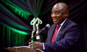 Man at podium in suit gesturing