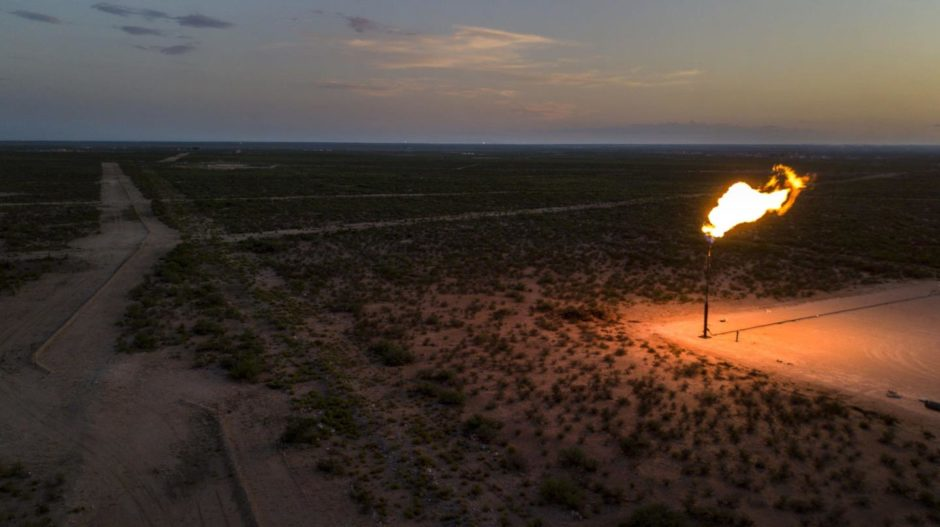 A gas flare is seen at dusk in this aerial photograph taken above a field near Mentone, Texas, U.S., on Saturday, Aug. 31, 2019.  Photographer: Bronte Wittpenn/Bloomberg