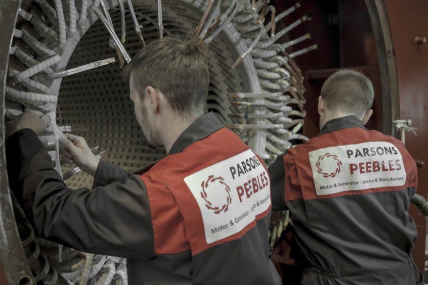 Parsons Peebles technicians at work.