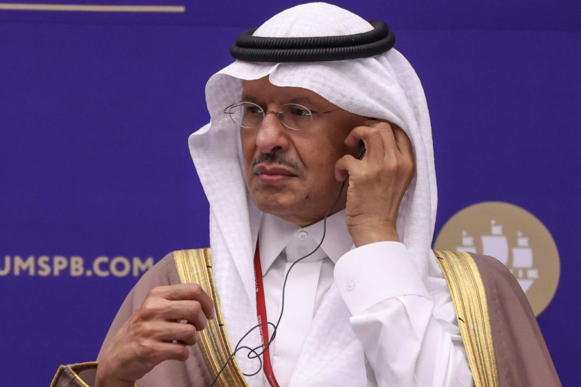 Abdulaziz bin Salman, Saudi Arabia's energy minister, adjusts his earpiece during a panel session on day two of the St. Petersburg International Economic Forum (SPIEF) in St. Petersburg, Russia, on Thursday, June 3, 2021.