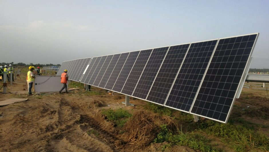 Solar panel with two workers in high-vis equipment