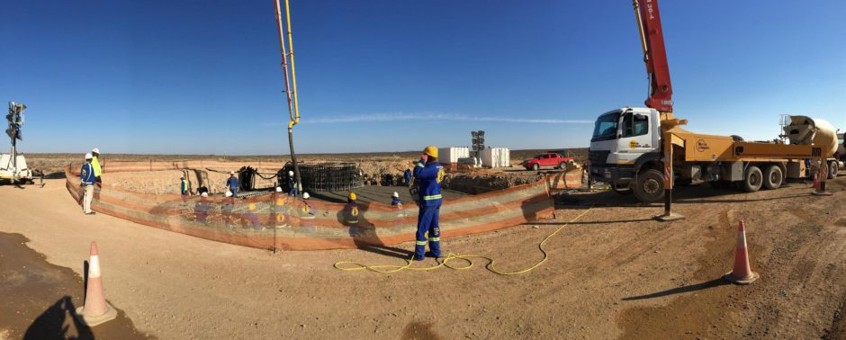 A panorama of a crane moving equipment