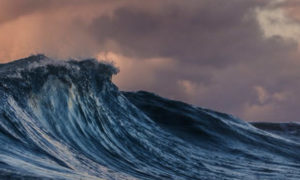 A wave against a dramatic background