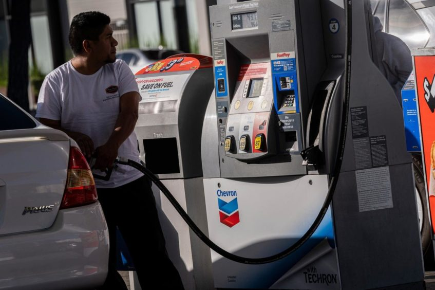 A customer refuels at a Chevron Corp. gas station in San Francisco, California, U.S., on Wednesday, July 7, 2021. The average price of gas nationwide has climbed to $3.13, a high for the year and up 40% since January 1, CBS News reports.