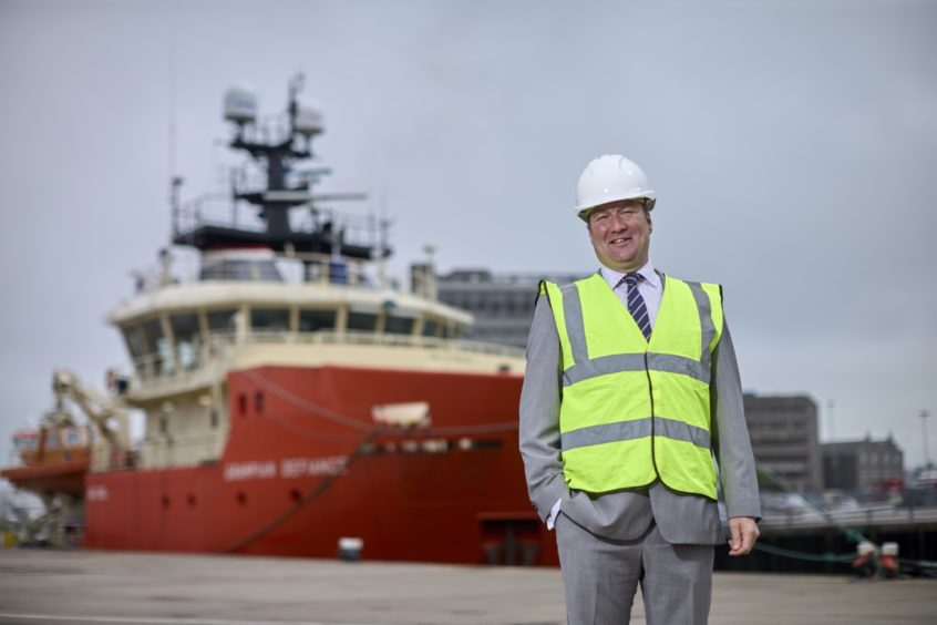North Star renewables director Andrew Duncan quayside in front of one the firm's D-class vessels with existing twin daughter craft.