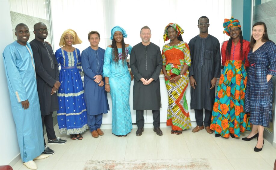 Group of people, some in Senegalese dress
