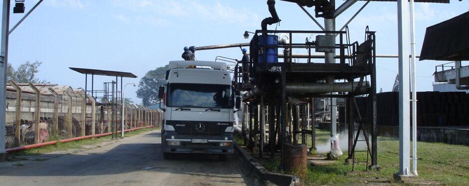 A lorry hooks up to a loading platform