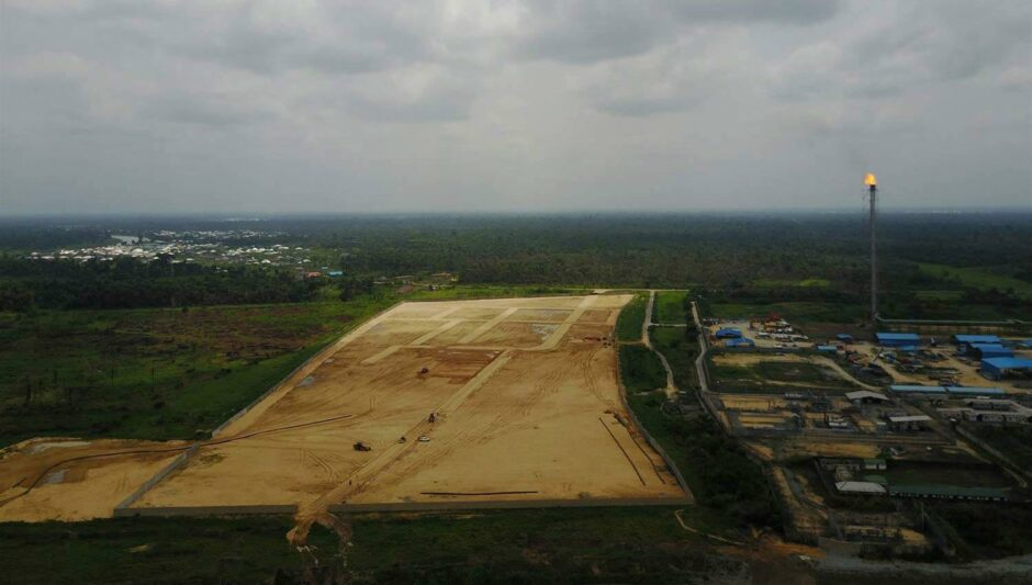 Aerial shot of cleared site with gas flare to right