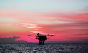 Offshore platform in Southeast Asia at sunset.  Supplied by Shutterstock.