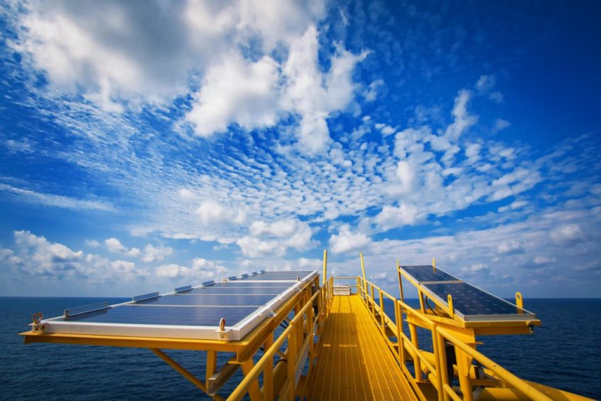 Solar cell panels supplying power to process control systems on an oil platform.