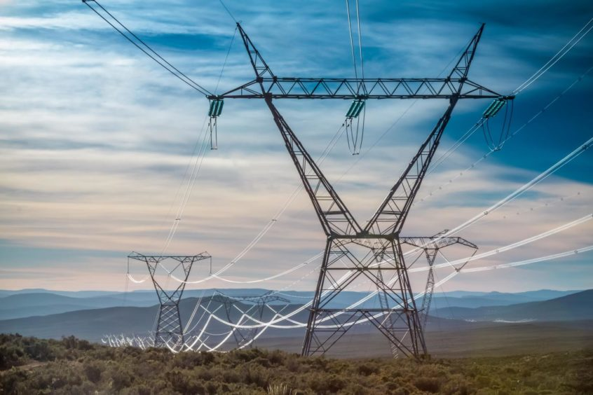 Electricity pylon with the early morning light gleaming off the cables in South Africa.