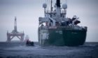 Greenpeace court BP