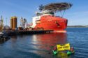 Greenpeace Norway activists in kayaks confront Siem Day loading drilling infrastructure for the Cambo oil field on behalf of Siccar Point Energy and Shell Oil, at Randaberg Industries, outside Stavanger, Norway.